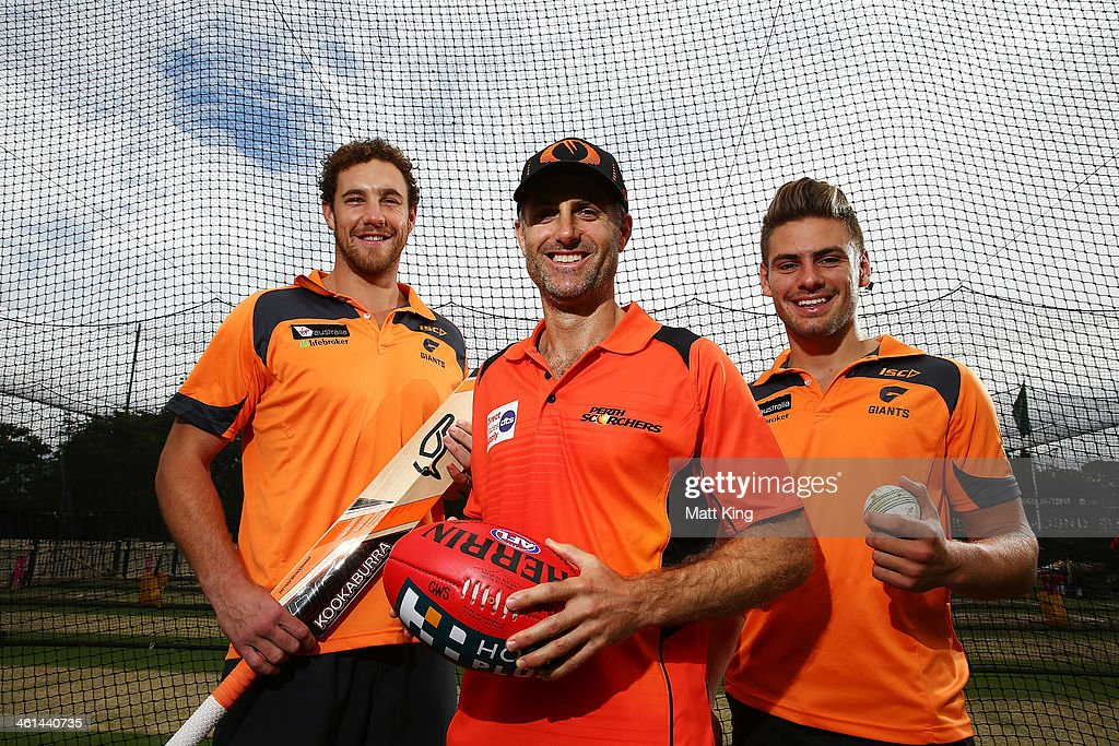 Shane Mumford (L) and Stephen Coniglio (R) of the Greater Western Sydney Giants pose with <a gi-track='captionPersonalityLinkClicked' href=/galleries/search?phrase=Simon+Katich&family=editorial&specificpeople=176577 ng-click='$event.stopPropagation()'>Simon Katich</a> (C) of the Scorchers during a Perth Scorchers Big Bash League training session at Sydney Cricket Ground on January 9, 2014 in Sydney, Australia.