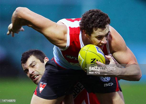 Shane Mumford is tackled by Martin Mattner during a Sydney Swans AFL training session at the Sydney Cricket Ground on June 26 2012 in Sydney Australia