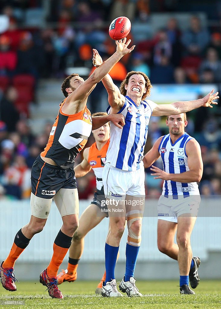 Shane Mumford of the Giants and Ben Brown of the Kangaroos contest possession during the round 20 AFL match between the Greater Western Sydney Giants and the North Melbourne Kangaroos at Stratrack Oval on August 9, 2014 in Canberra, Australia.