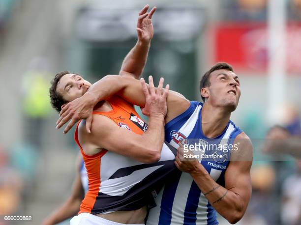 Shane Mumford of the Giants and Braydon Preuss of the Kangaroos compete for the ball during the round three AFL match between the North Melbourne...