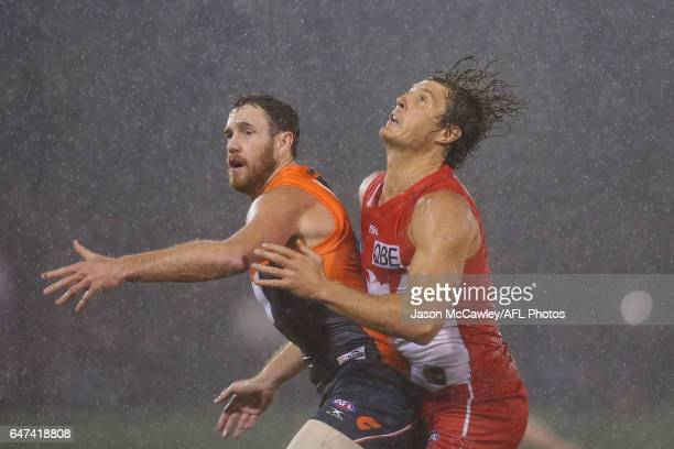 Shane Mumford of the Giants and Kurt Tippett of the Swans compete for the ball during the 2017 JLT Community Series AFL match between the Greater...