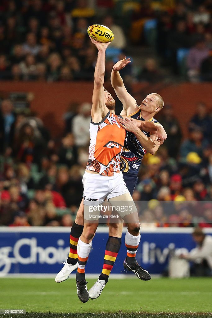 Shane Mumford of the Giants and Sam Jacobs of the Crows compete in the ruck during the round 10 AFL match between the Adelaide Crows and the Greater Western Sydney Giants at Adelaide Oval on May 28, 2016 in Adelaide, Australia.