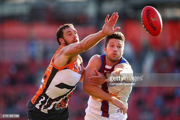 Shane Mumford of the Giants and Stefan Martin of the Lions contest the ball during the round 10 AFL match between the Greater Western Sydney Giants...