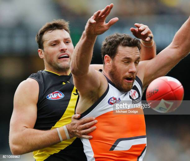 Shane Mumford of the Giants and Toby Nankervis of the Tigers compete for the ball during the round 18 AFL match between the Richmond Tigers and the...