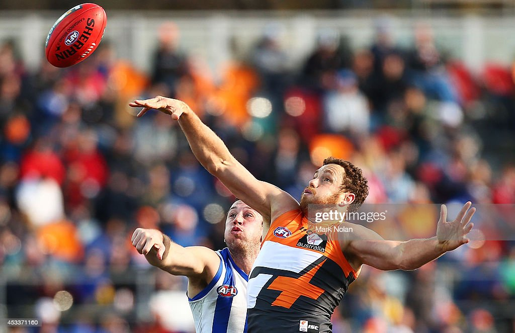 Shane Mumford of the Giants and Todd Goldstein of the Kangaroos contest possession during the round 20 AFL match between the Greater Western Sydney Giants and the North Melbourne Kangaroos at Stratrack Oval on August 9, 2014 in Canberra, Australia.
