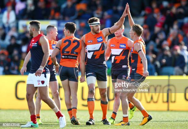 Shane Mumford of the Giants celebrates a goal during the round 20 AFL match between the Greater Western Sydney Giants and the Melbourne Demons at...