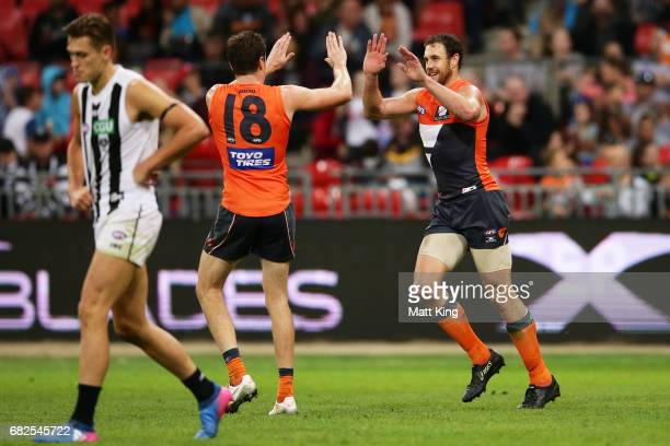 Shane Mumford of the Giants celebrates a goal during the round eight AFL match between the Greater Western Sydney Giants and the Collingwood Magpies...