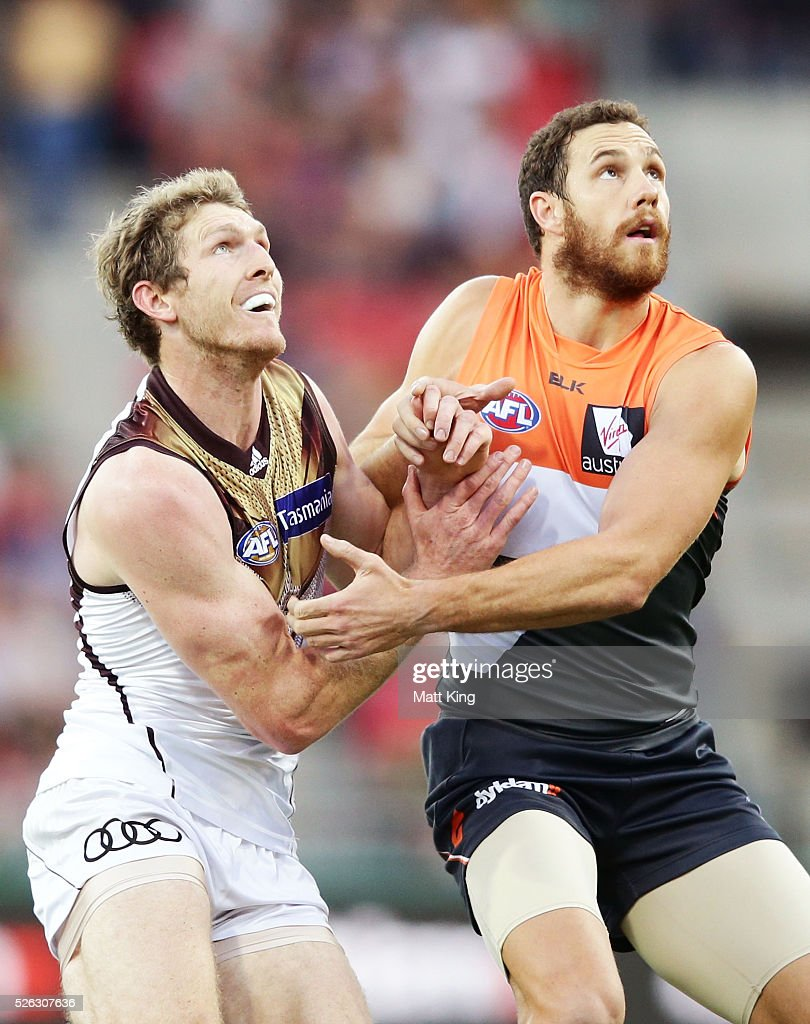 Shane Mumford of the Giants competes for the ball against Ben McEvoy of the Hawks during the round six AFL match between the Greater Western Sydney Giants and the Hawthorn Hawks at Spotless Stadium on April 30, 2016 in Sydney, Australia.
