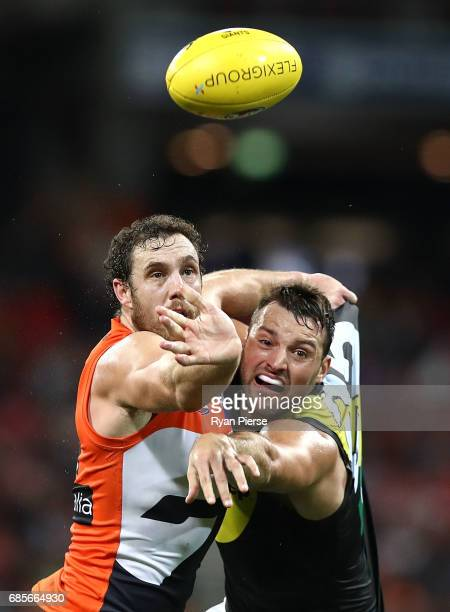 Shane Mumford of the Giants competes for the ball against Toby Nankervis of the Tigers during the round nine AFL match between the Greater Western...