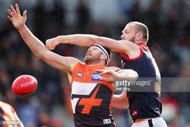 Shane Mumford of the Giants is challenged by Max Gawn of the Demons during the round 20 AFL match between the Greater Western Sydney Giants and the...