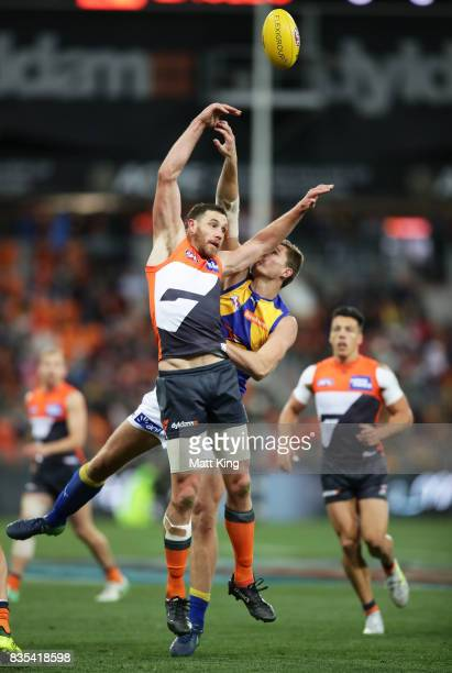 Shane Mumford of the Giants is challenged by Nathan Vardy of the Eagles during the round 22 AFL match between the Greater Western Sydney Giants and...