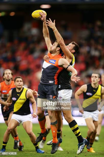 Shane Mumford of the Giants is challenged by Toby Nankervis of the Tigers during the round nine AFL match between the Greater Western Sydney Giants...