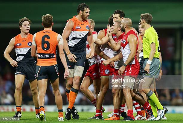 Shane Mumford of the Giants scuffles with Swans players during the round three AFL match between the Sydney Swans and the Greater Western Sydney...