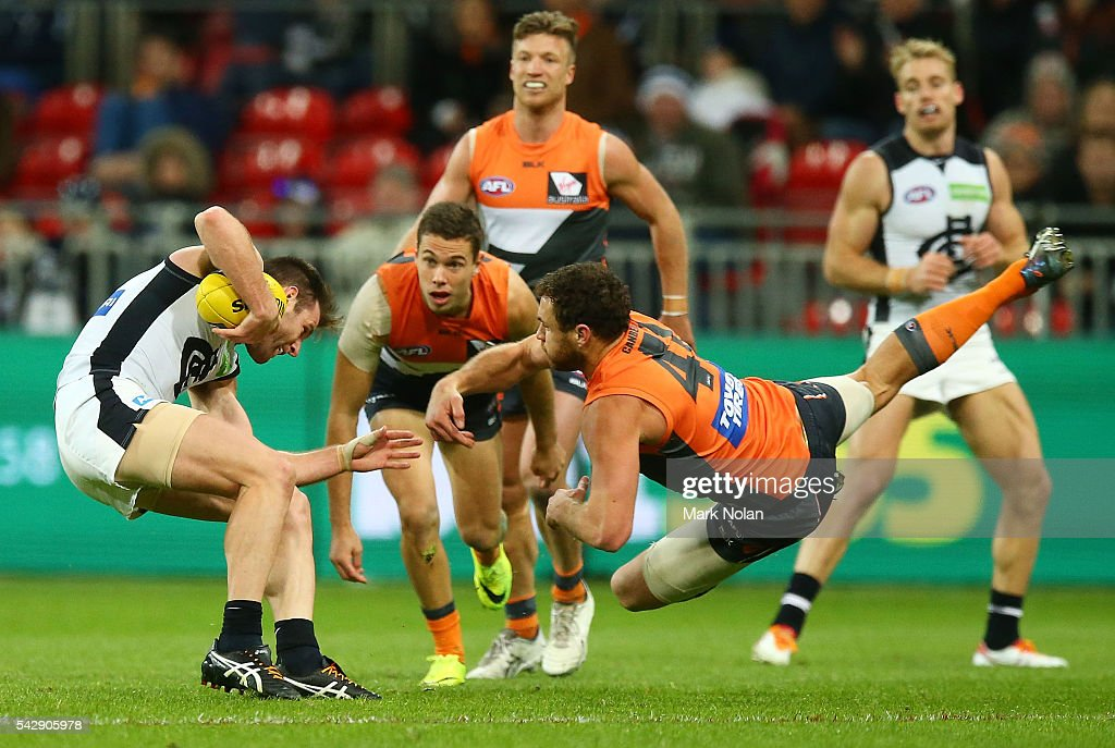 Shane Mumford of the Giants tackles Sam Doherty of Carlton during the round 14 AFL match between the Greater Western Sydney Giants and the Carlton Blues at Spotless Stadium on June 25, 2016 in Sydney, Australia.