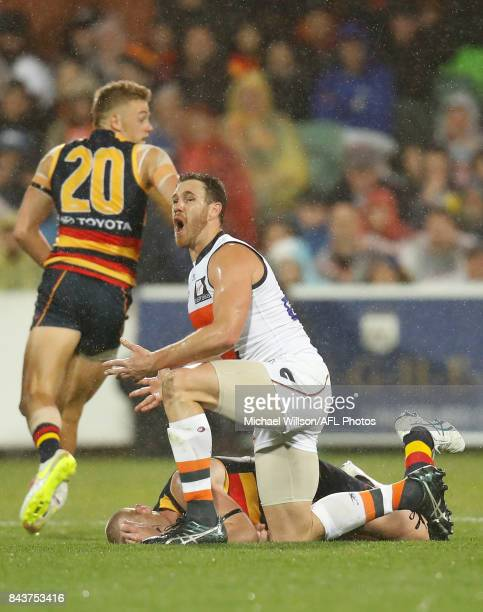 Shane Mumford of the Giants tackles Sam Jacobs of the Crows during the AFL First Qualifying Final match between the Adelaide Crows and the Greater...