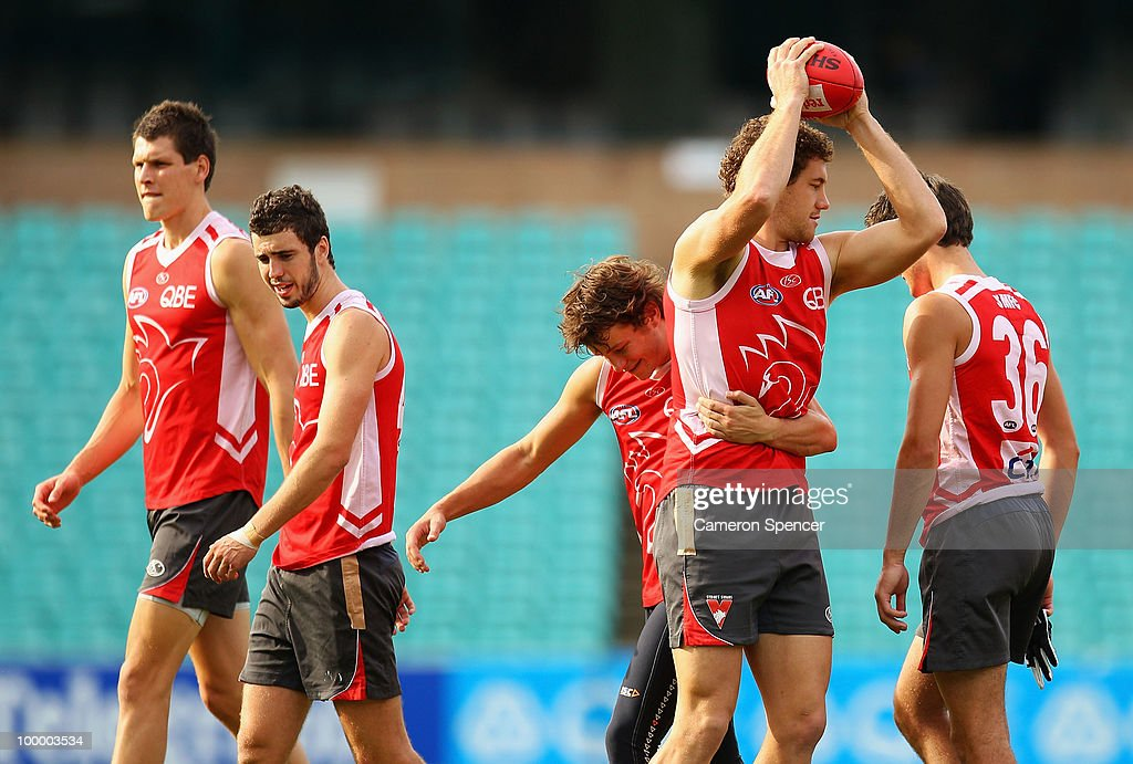 Shane Mumford of the Swans is tackled during a Sydney Swans AFL training session at the Sydney Cricket Ground on May 20, 2010 in Sydney, Australia.