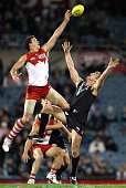 Shane Mumford of the Swans wins the ball over Dean Brogan of the Power during the round 12 AFL match between the Port Adelaide Power and the Sydney...