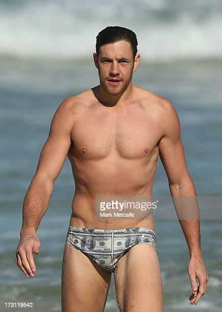 Shane Mumford walks from the ocean during a Sydney Swans AFL recovery session at North Bondi Beach on July 8 2013 in Sydney Australia