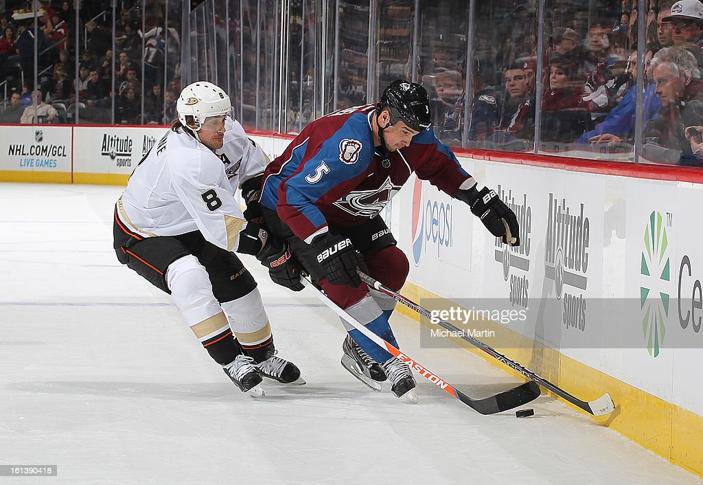 Shane O'Brien #5 of the Colorado Avalanche is defended by Teemu Selanne #8 of the Anaheim Ducks at the Pepsi Center on February 6, 2013 in Denver, Colorado.