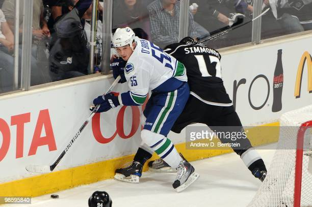 Shane O'Brien of the Vancouver Canucks battles for the puck against Wayne Simmonds of the Los Angeles Kings in Game Three of the Western Conference...