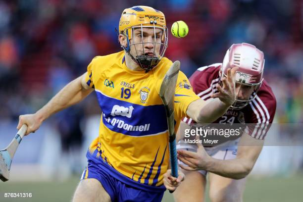 Shane O'Donnell of Clare runs past Padraig Breheny of Galway during the 2017 AIG Fenway Hurling Classic and Irish Festival at Fenway Park on November...