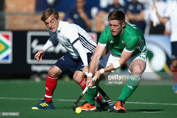 Shane O'Donoghue of Ireland and Hugo Genestet of France battle for possession during the 5th8th place play off match between Ireland and France on...
