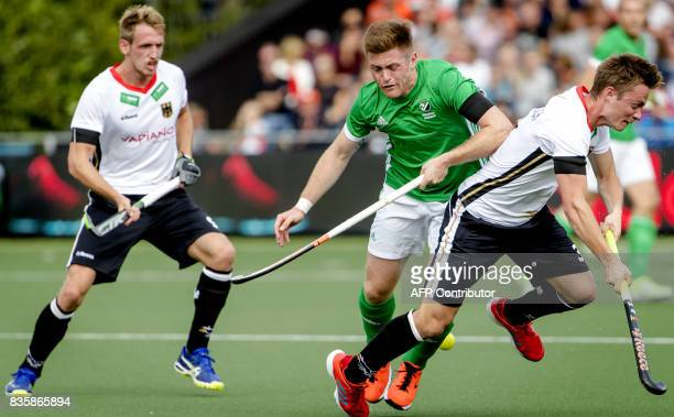 Shane O'Donoghue of Ireland fights for the ball with Mats Grambusch of Germany during the men's Rabo EuroHockey Championships 2017 match between...