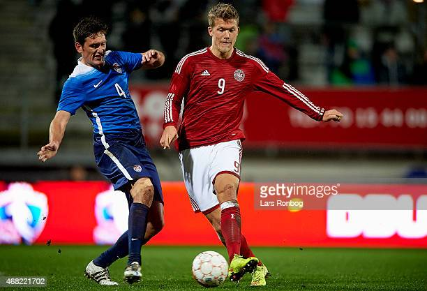Shane O'Neill of Unites States U21 Soccer Team and Andreas Cornelius of Denmark U21 compete for the ball during the U21 International Friendly match...