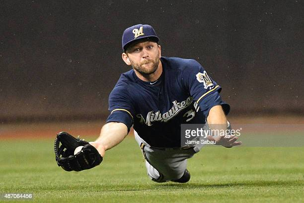 Shane Peterson of the Milwaukee Brewers makes a diving catch for an out off a hit from Jason Bourgeois of the Cincinnati Reds in the fifth inning at...