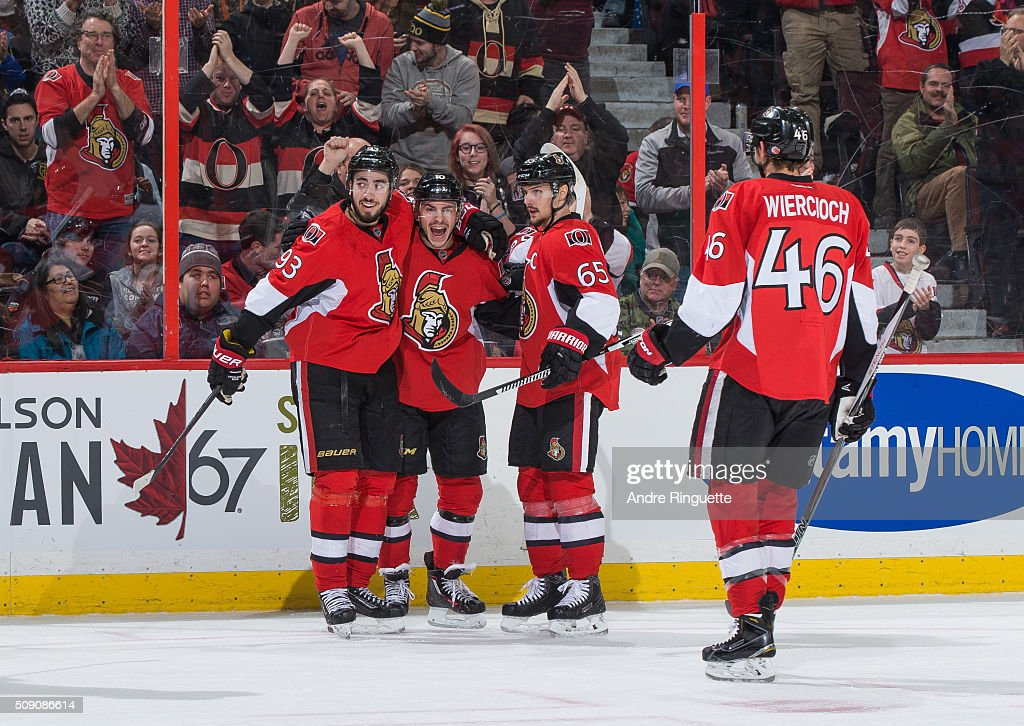 Shane Prince #10 of the Ottawa Senators celebrates his first period goal against the Tampa Bay Lightning with teammates <a gi-track='captionPersonalityLinkClicked' href=/galleries/search?phrase=Mika+Zibanejad&family=editorial&specificpeople=7832310 ng-click='$event.stopPropagation()'>Mika Zibanejad</a> #93, <a gi-track='captionPersonalityLinkClicked' href=/galleries/search?phrase=Erik+Karlsson&family=editorial&specificpeople=5370939 ng-click='$event.stopPropagation()'>Erik Karlsson</a> #65 and <a gi-track='captionPersonalityLinkClicked' href=/galleries/search?phrase=Patrick+Wiercioch&family=editorial&specificpeople=5408887 ng-click='$event.stopPropagation()'>Patrick Wiercioch</a> #46 at Canadian Tire Centre on February 8, 2016 in Ottawa, Ontario, Canada.