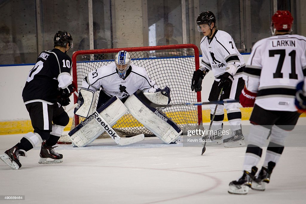 Shane Prince #10 of the Ottawa Senators takes a shot on <a gi-track='captionPersonalityLinkClicked' href=/galleries/search?phrase=Connor+Hellebuyck&family=editorial&specificpeople=10551764 ng-click='$event.stopPropagation()'>Connor Hellebuyck</a> #37 of the Winnipeg Jets, with <a gi-track='captionPersonalityLinkClicked' href=/galleries/search?phrase=Julius+Honka&family=editorial&specificpeople=9966154 ng-click='$event.stopPropagation()'>Julius Honka</a> #7 of the Dallas Stars and <a gi-track='captionPersonalityLinkClicked' href=/galleries/search?phrase=Dylan+Larkin&family=editorial&specificpeople=12867695 ng-click='$event.stopPropagation()'>Dylan Larkin</a> #71 of the Detroit Red Wings waiting for the rebound. The players were part of a scrimmage at the 2015 NHLPA Rookie Showcase at Mattamy Athletic Centre on September 1, 2015 in Toronto , Ontario , Canada .