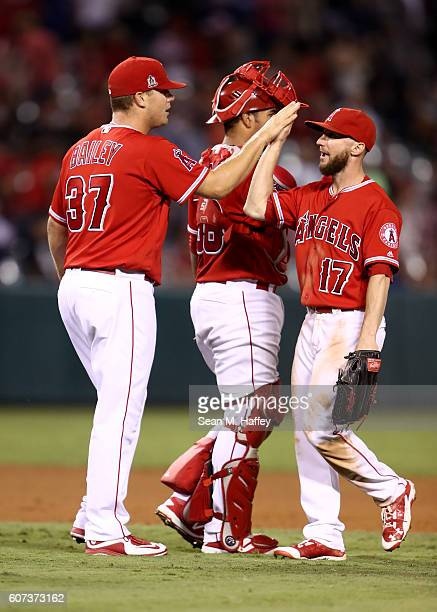 Shane Robinson Andrew Bailey and Carlos Perez of the Los Angeles Angels of Anaheim celebrate a 61 victory over the Toronto Blue Jays at Angel Stadium...