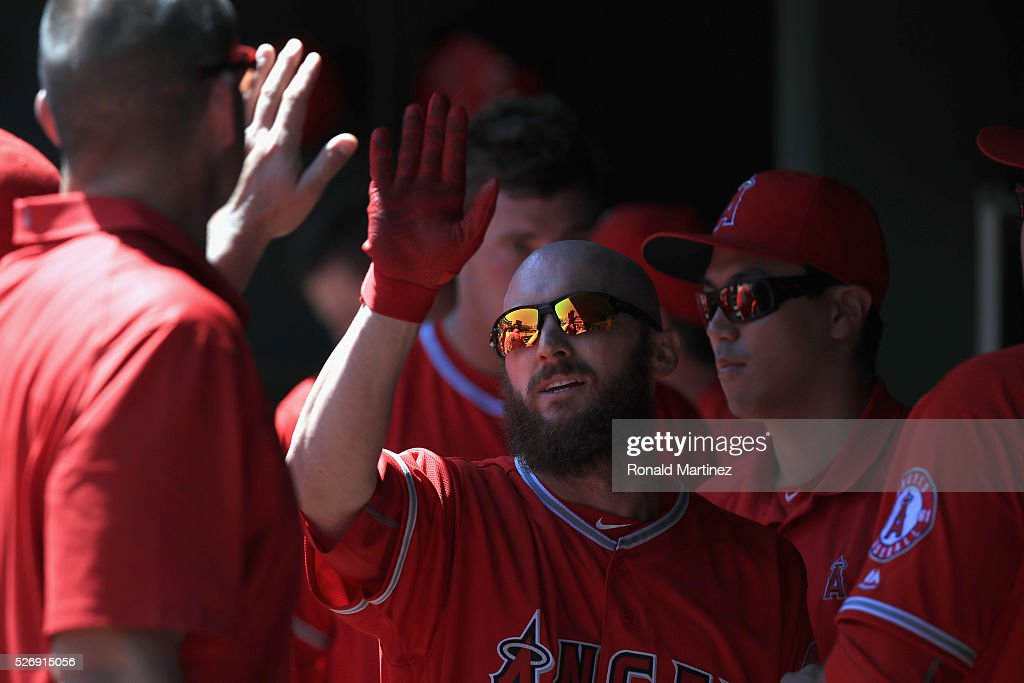 Shane Robinson #17 of the Los Angeles Angels celebrates a run against the Texas Rangers in the third inning at Globe Life Park in Arlington on May 1, 2016 in Arlington, Texas.