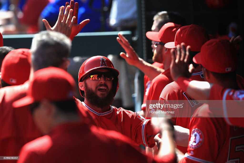 Shane Robinson #17 of the Los Angeles Angels celebrates a run against the Texas Rangers in the sixth inning at Globe Life Park in Arlington on May 1, 2016 in Arlington, Texas.