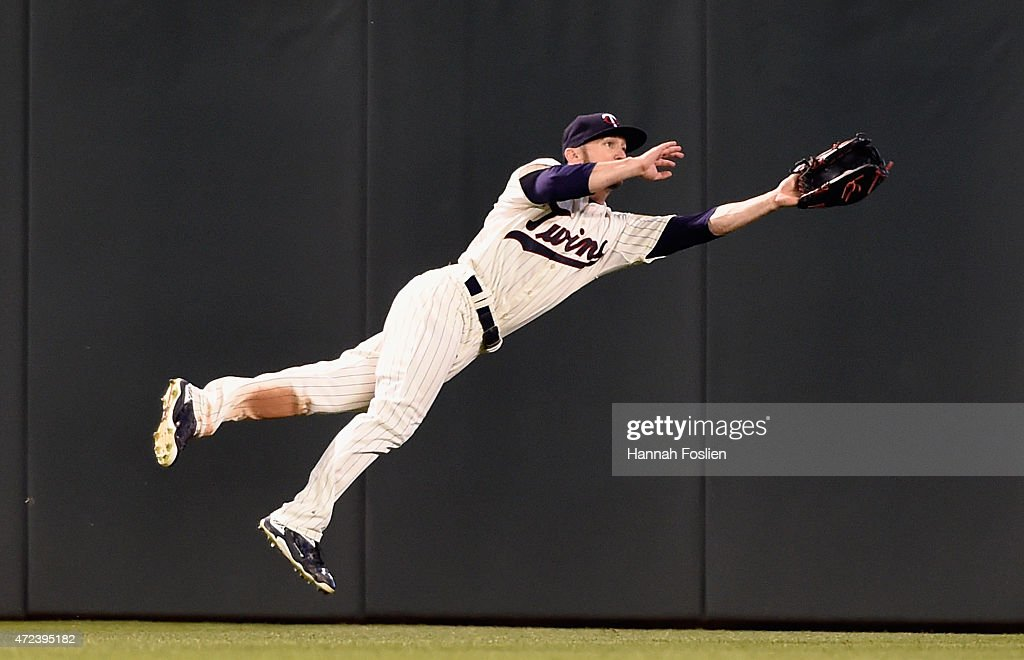 Shane Robinson #21 of the Minnesota Twins makes a diving catch in center field on a ball off the bat of Josh Phegley #19 of the Oakland Athletics to end the game on May 6, 2015 at Target Field in Minneapolis, Minnesota. The Twins defeated Athletics 13-0.