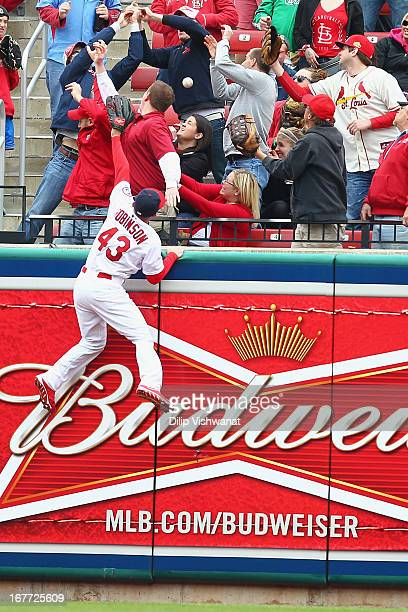 Shane Robinson of the St Louis Cardinals attempts to catch a home run hit by Russell Martin of the Pittsburgh Pirates in the second inning at Busch...