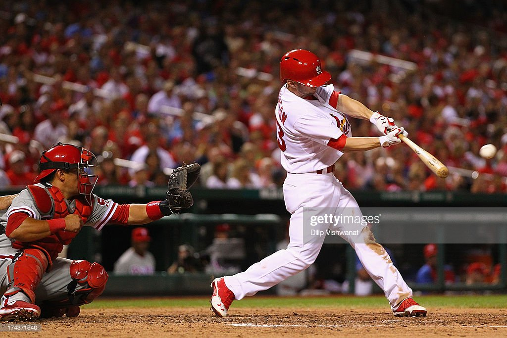 Shane Robinson #43 of the St. Louis Cardinals hits a three-RBI triple against the Philadelphia Phillies in the fifth inning at Busch Stadium on July 24, 2013 in St. Louis, Missouri. The Cardinals beat the Phillies 11-3.
