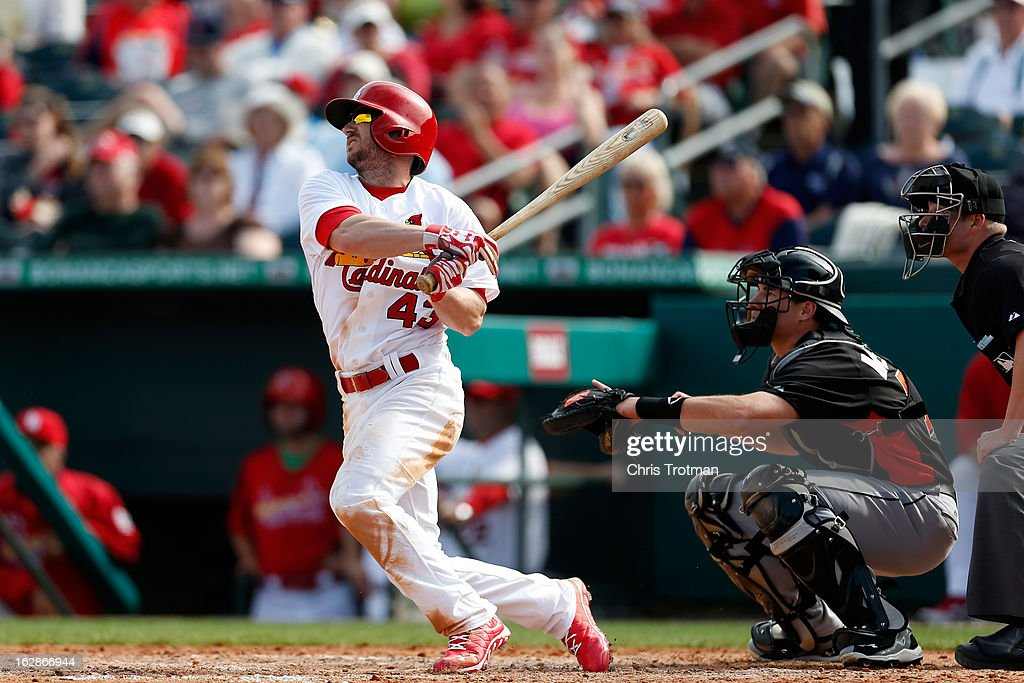 Shane Robinson #43 of the St. Louis Cardinals swings during the game against the Miami Marlins at the Roger Dean Stadium on February 28, 2013 in Jupiter, Florida.