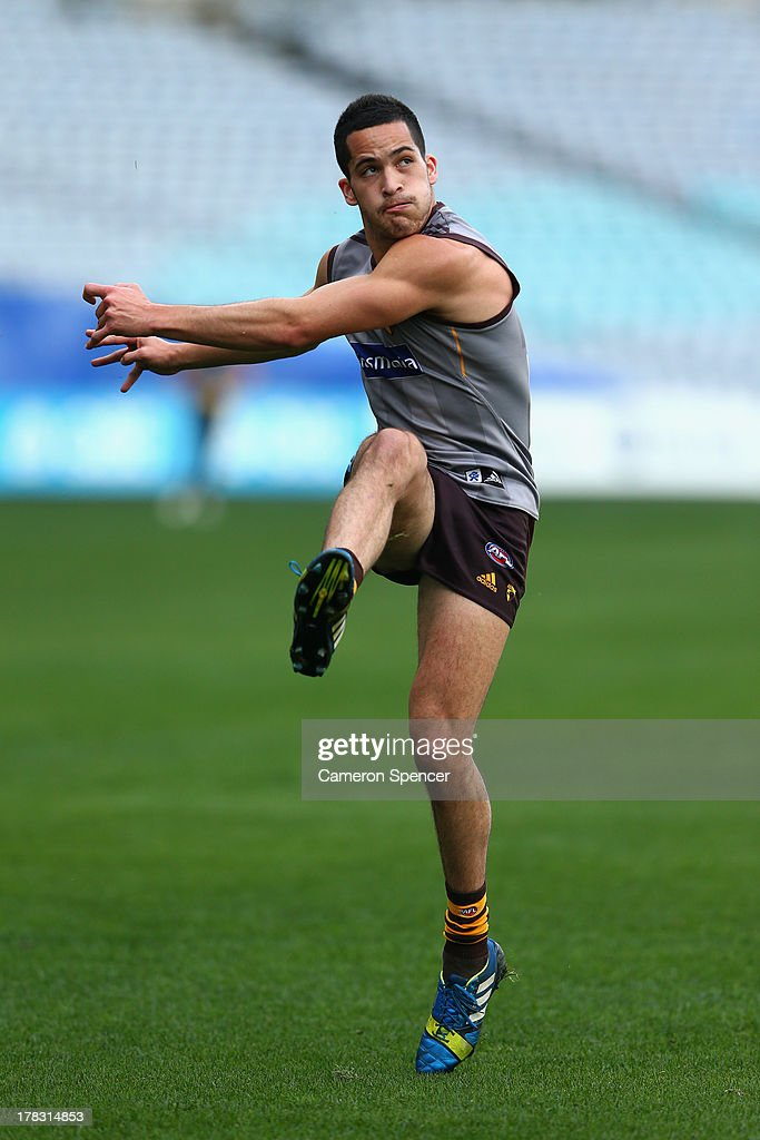 Shane Savage of the Hawks kicks during a Hawthorn Hawks AFL training session at ANZ Stadium on August 29, 2013 in Sydney, Australia.