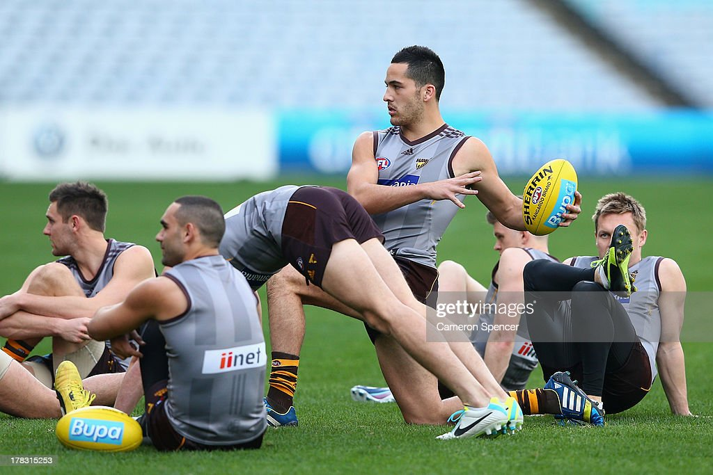Shane Savage of the Hawks stretches during a Hawthorn Hawks AFL training session at ANZ Stadium on August 29, 2013 in Sydney, Australia.