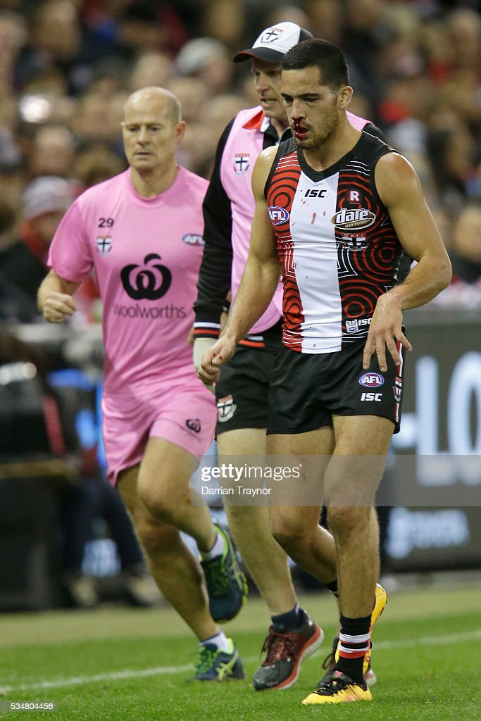 Shane Savage of the Saints heads to the bench under the blood rule during the round 10 AFL match between the St Kilda Saints and the Fremantle Dockers at Etihad Stadium on May 28, 2016 in Melbourne, Australia.
