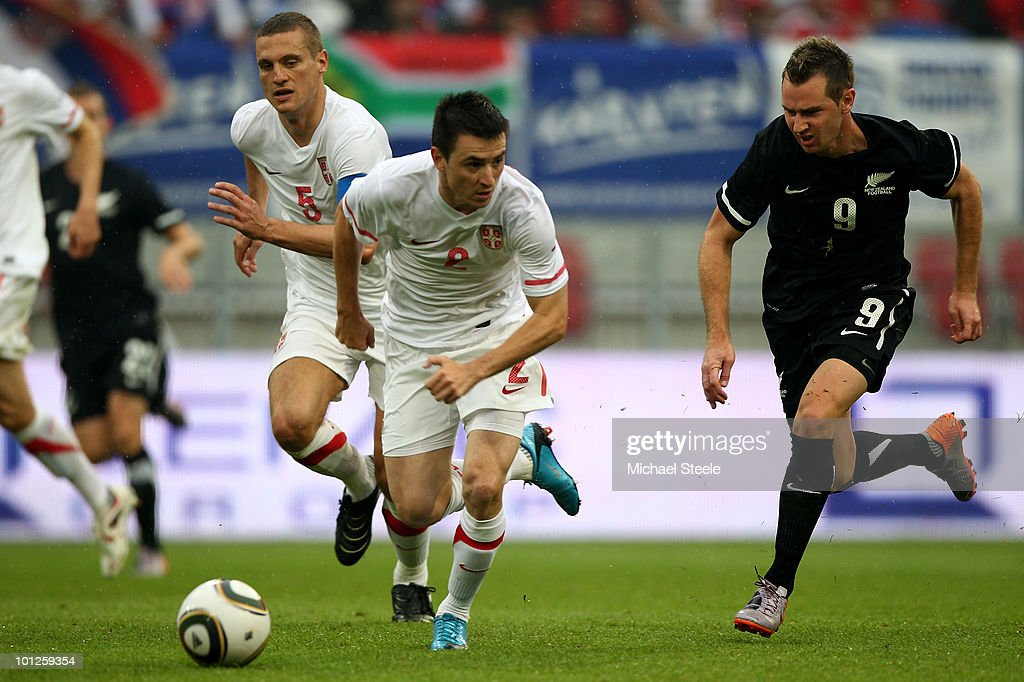 Shane Smeltz (r) of New Zealand chases down Antonio Rukavina during the New Zealand v Serbia International Friendly match at the Hypo Group Arena on May 29, 2010 in Klagenfurt, Austria.