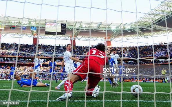 Shane Smeltz of New Zealand scores the opening goal against goalkeeper Federico Marchetti of Italy while Fabio Cannavaro of Italy can just look on...
