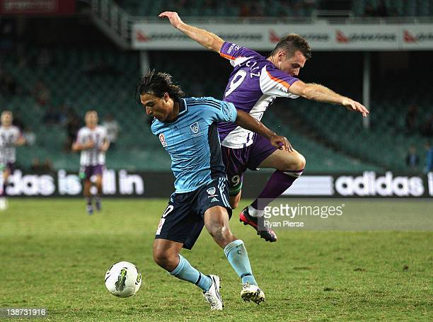 Shane Smeltz of Perth and Nick Carle of Sydney compete for the ball during the round 19 ALeague match between Sydney FC and Perth Glory at Sydney...
