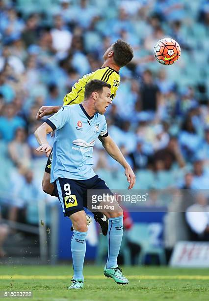 Shane Smeltz of Sydney FC and Ben Sigmund of Wellington Phoenix compete for the ball during the round 23 ALeague match between Sydney FC and the...