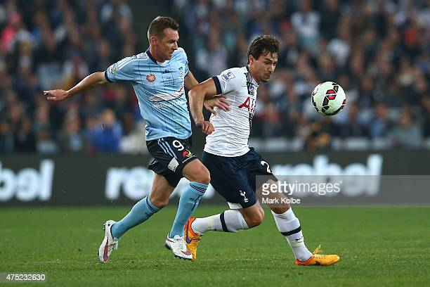 Shane Smeltz of Sydney FC and Benjamin Stambouli of Tottenham Hotspur compete for the ball during the international friendly match between Sydney FC...