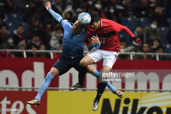 Shane Smeltz of Sydney FC and Mitsuru Nagata of Urawa Red Diamonds compete for the ball during the AFC Champions League Group H match between Urawa...