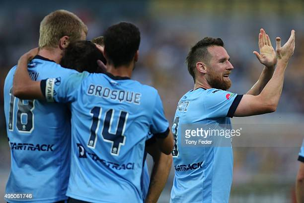 Shane Smeltz of Sydney FC applauds after Sydney scored a goal during the round four ALeague match between the Central Coast Mariners and Sydney FC at...