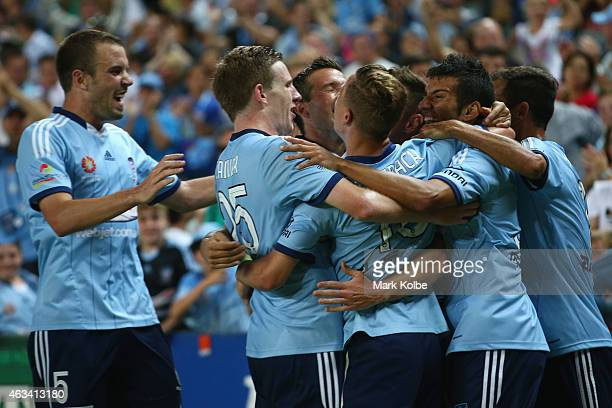 Shane Smeltz of Sydney FC celebrates with his team mates after scoring his second goal during the round 17 ALeague match between Sydney FC and...