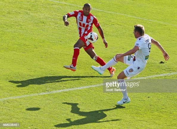 Shane Smeltz of the Glory and Patrick Kisnorbo of the Heart compete for the ball during the round 18 ALeague match between Melbourne Heart and Perth...